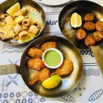 Calamari with lemon butter, crispy prawn tails and fish cakes
