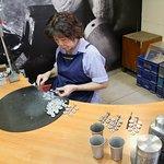 "Craftwoman making a pewter ""money tree"""