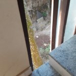 Broken window on stairwell