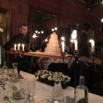 Cake being brought out after dinner at the wedding