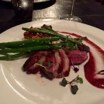 Pan seared duck with pumpkin, leek and sage bread pudding and green beans