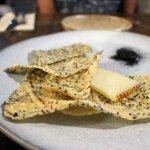 Manchego with hibiscus, potato cracker and black quinoa