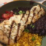 Grilled grouper over black beans and rice