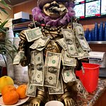 Buddha with money clothes