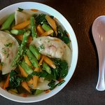 Late spring vegetarian dumpling soup with asparagus