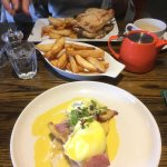 Eggs Benedict beautifully presented with thrice cooked chips as a side . Triple layered Club san