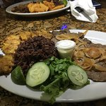 The Palomilla Steak Dinner with tostones and Congri rice.