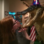 An adult looks into Alfie's giant-sized alligator's mouth