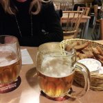 "Pilsner Urquell beers + ""Havranovy tyčinky"" (hot breadsticks rubbed with garlic + sauce)"