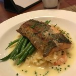 Fresh trout with fresh green beans over risotto and shrimp