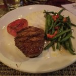 filet with green beans, mashed potatoes, and a tomato