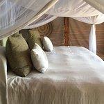 Bed in lodge room on Sindabezi Island