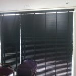 Blinds do not cover Sunlight in room.