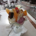 Trio of ice cream with summer fruit and nuts
