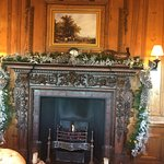 decorated fireplace in the library area