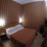 Nice bedroom with wooden floor