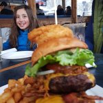 One of the kids and the burger bigger than her!