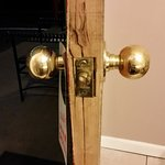 """The four (4) fissures in the door and the bolt that moved more than 1/2"""" either way"""