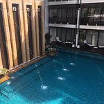 View from top floor room. Beautiful pool. Always quiet.