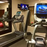 Small fitness room with two pieces of Precor equipment