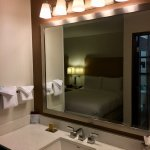 Room 307 -- sink and mirror are in the main room; toilet and shower are in a separate room