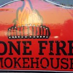 Outside signage for Bone Fire Smokehouse in downtown Abingdon, VA