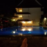Relaxing at the pool in the evening.  The desk where you order drinks is right behind me.