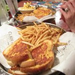 This photo shows the adult grilled cheese in front and child's in back, same size!