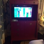 Neat wallpaper and bureau...not so neat TV picture quality. Pixelated/scrambled HGTV