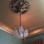 just look at this awesome chandelier, molding and wallpaper