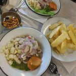 Mushroom ceviche in the front and mixto ceviche in the back along with yuca fries.