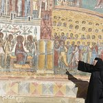The nun who is the guide (in 3 languages), explaining details on the Last Judgement fresco