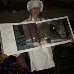 "Our train car attendant displaying the book ""The Polar Express"""