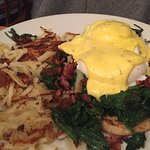 Eggs Benedict with spinach and hash browns