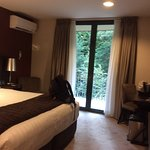 """""""Deluxe"""" (ie bottom tier) room overlooking the forest in the Waterfall building."""