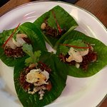 Smoked Trout on betel leaf with grapefruit herbs and nham- jim sauce