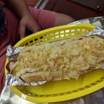 Hot dog with lots of crushed potato chips on top