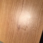 stained and unclean bedside tables