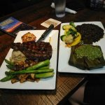 Ribeye, asparagus, mashed, and blue cheese tomator; Snapper in banana leaves, black beans and ve