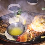 Hot plate with lobster and steak with butter and grilled onions