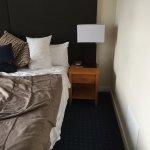 Big bed tiny room.