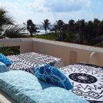 Sun beds on rooftop terrace