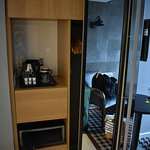 Safe, coffee maker, mirrored closet and tv
