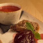 Basil panna cotta with poached tamarillo, cinnamon & ginger beignet