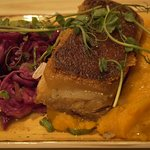 Caramelised pork belly on roast carrot puree with pickled red cabbage & grain mustard jus