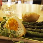 Seared asparagus topped with crispy coated free-range egg, balsamic & truffle oil