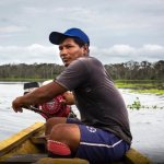 Local family boat driver in Tambopata national reserve Peru
