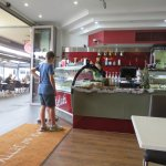 Choosing ice cream at the counter of Crema at the Jetty, Glenelg