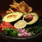 Our Top Shelf Guacamole is prepared table side.