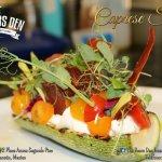 Our Caprese salad, crispy serrano ham, burrata cheese, organic tomatoes, grilled zucchini.